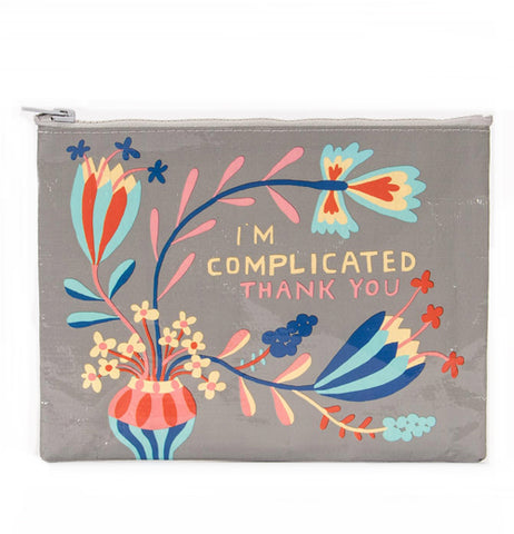 "A gray bag with a gray zipper with the picture of a vase with flowers sprouting from it and the words ""I'm Complicated Thank you""."