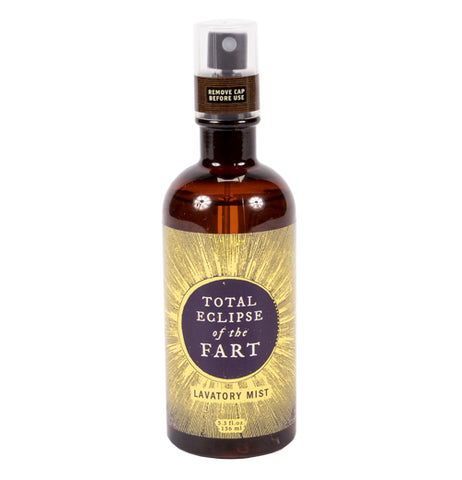 "The Eclipse of the Fart Lavatory Mist mist comes in a brown bottle with a gold label with an eclipsed son design and text that reads ""Total Eclipse of the Fart"""