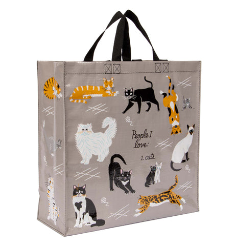 "This large gray bag with black handles has a design of different breeds of house cat. In the middle of the bag, in black lettering, are the words, ""People I Love: 1. Cats""."