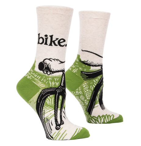 "The pair of the ""Bike Path"" crew socks features a design of a bike rider holding onto the handles riding down a green path with a word, ""Bike"" in black."