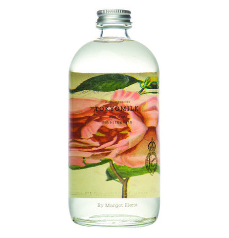 This bubble bath bottle has an illustration of a pink rose.