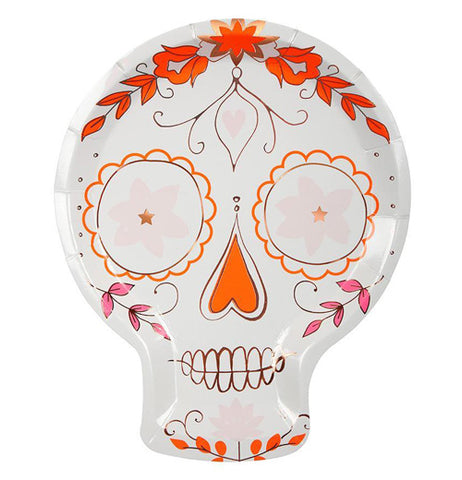 "The ""Sugar Skull"" paper plate has a design of a traditional sugar skull with orange, pink, and copper floral designs outlining the skull's features."