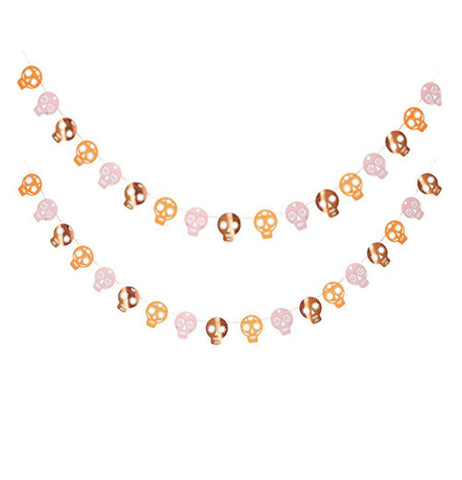 "The ""Sugar Skull"" Garland have copper, gold , and silver foil sugar skulls on a string."