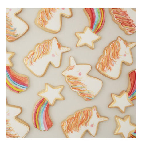 A bunch of decorated cookies that have been made with the unicorn and shooting star cookie cutters.