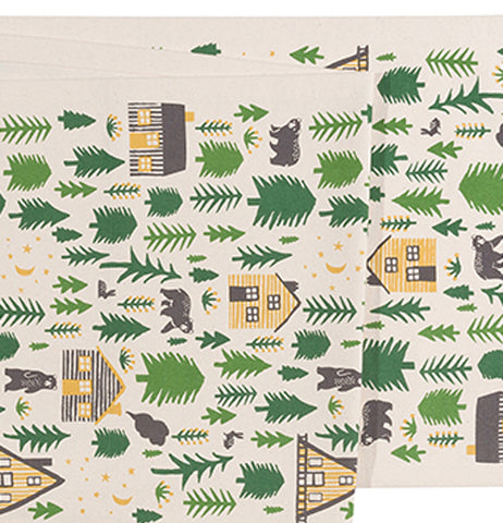 This is a close up of the cabin, bear, and forest design covering the table cloth.