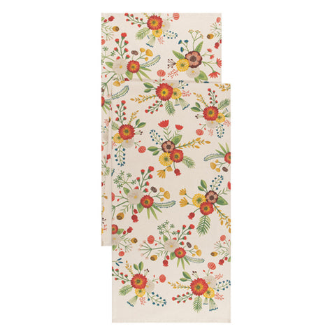This cream colored table runner has a design of red, purple, and yellow flowers covering it.