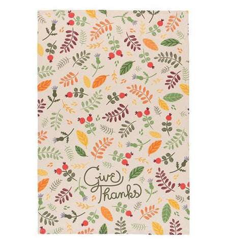 "The Tea Towel ""Give Thanks"" has a design of red, orange, green, and yellow foliage with two green words, ""Give Thanks"" on a cream colored fabric"