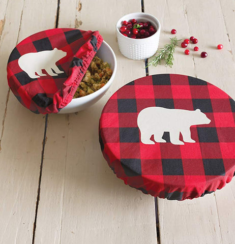 "The set of 2 red plaid ""Buffalo Check Bear"" bowl covers over two bowls on a white wooden table."