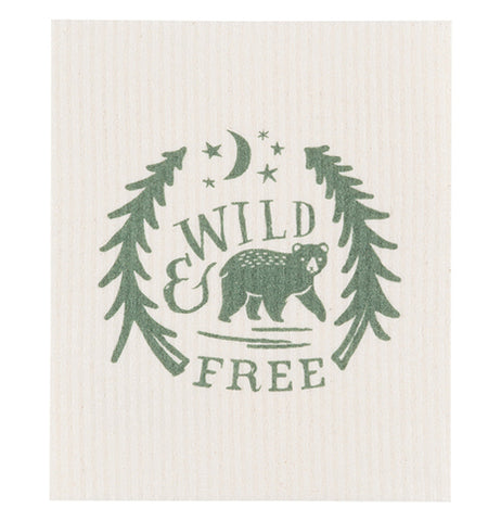 "This cream colored dishcloth features a green design of a bear walking between two trees under stars and a moon. The words, ""Wild & Free"" are shown above and below the bear in green lettering."