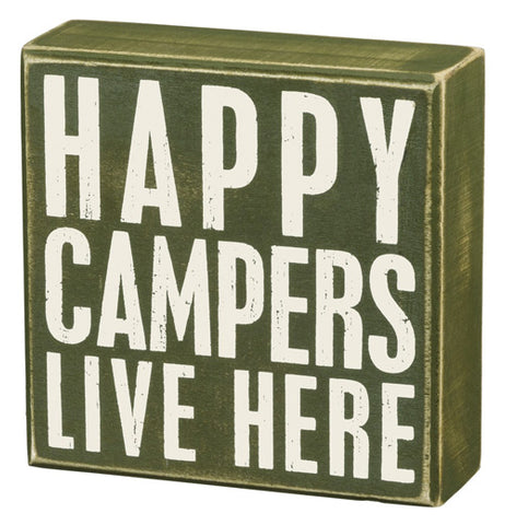 "The ""Happy Campers"" Box Sign has white letters that say ""Happy Campers live here"" over a green background."