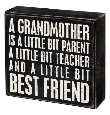"This black box sign has the words, ""A Grandmother Is A Little Bit Parent A Little Bit Teacher And A Little Bit Best Friend"" in white lettering."