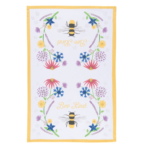 "This white tea towel with a yellow rim surrounding its edges sports a design of bees and red, purple, yellow, and blue flowers and yellow text that reads ""Bee Kind""."