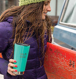 The lid is shown sealing the top of a teal green water bottle held by a woman in a purple parka vest and a green hat.
