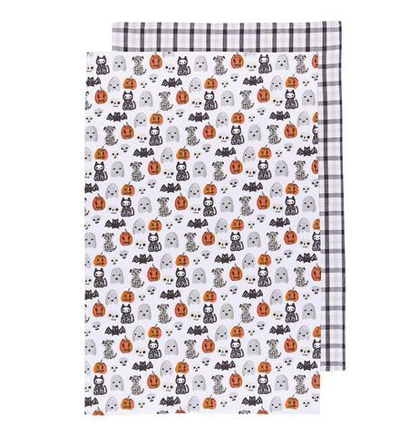 "The Tea Towel ""Happy Halloween"" features a design of pumpkins, skulls, ghosts, bats, mummies, black cats, and bats on a white background while the other a black and gray plaid design."