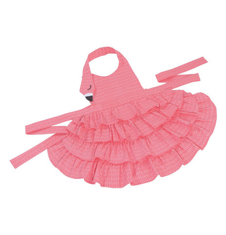 The pink flamingo apron is shown unfolded with the waist ties laid out.