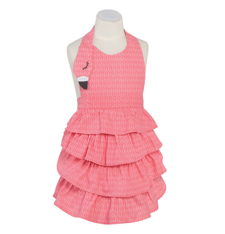 This hot pink apron with light pink spots has frills on the bottom half and a collar ending in a shape like a flamingo's head and beak and is shown displayed on a mannequin bust.