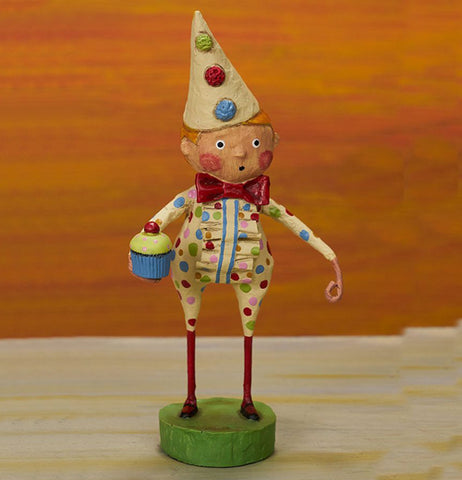 The Birthday Boy figurine is shown standing on a wooden shelf.