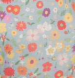 "The close-up of the colorful floral design over a light gray background from the ""Flowers of the Month"" Apron."