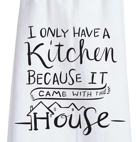 "This close-up is of the white dish towel containing the black text saying, ""I Only Have a Kitchen Because It Came With The House"" on it."