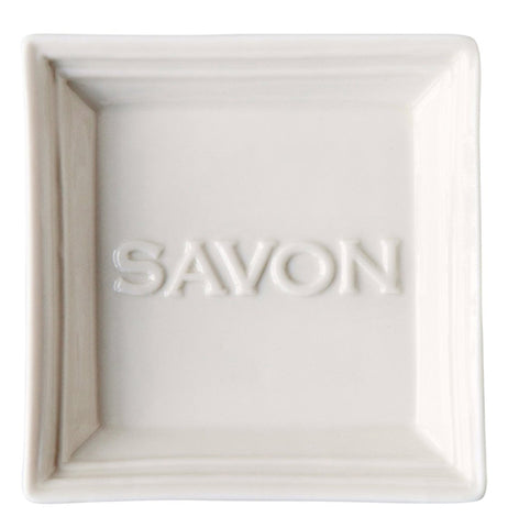 "This soap holding dish is shown with the word, ""Savon"" stenciled in the middle."