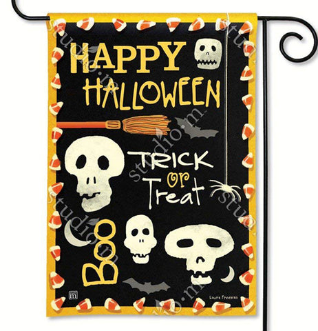 "This black garden flag features a design of white skulls, grey bats, and white spiders. An orange and brown broomstick with the words, ""Happy Halloween"" in yellow lettering are at the top. The words, ""Trick or Treat"" are in white and yellow lettering in the middle of the flag. The word, ""Boo"" is in yellow lettering at the bottom of the flag. The flag design is lined with candy corn pieces around the golden edges. Holding the flag is a black metal hanger."