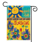Blue, orange, green, red, purple, turquoise, and yellow polyester garden flag that features a sun and flower design that says Good Day Sunshine.