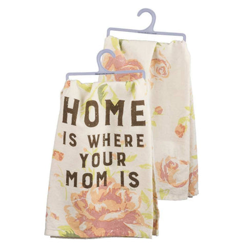 "A front and back view of a faded floral print towel. The front reads ""Home is Where Your Mom Is"" and the back has the faded floral print of roses on a white background."