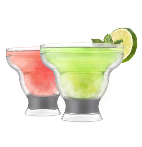 Freeze Margarita Cooling Cups that are clear and black with liquid in them.