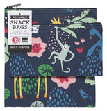 "The two black lunch bags with the giraffe and monkey pictures are shown together with their tags. The words, ""Snack Bags"" are written in black lettering against the white tags."