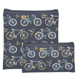 Two black cotton zippered pouches with images of 3 different styled bicycles. Two are light blue with white tires and the other is white with gold tires. The bags are stacked on top of each other and one bag is taller than the other.