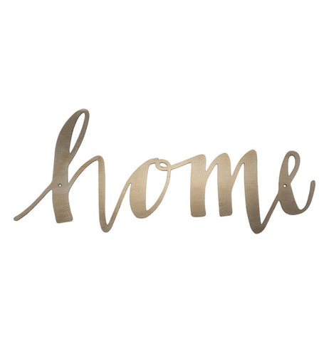 "A metal cutout sign of the word ""home"" in gold cursive letters"