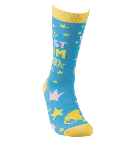 "These sky blue socks have yellow tops, bottoms, and heels. Scattered across the blue background are yellow and pink drawings of stars and cups. In the middle of the sock near the top are the words, ""Best Mom Ever"" in pink and yellow lettering."