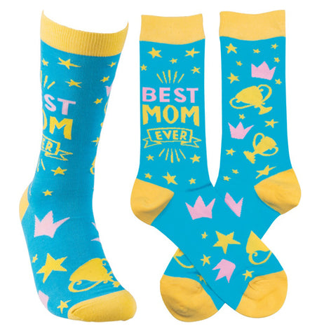 "This image shows the socks from three different angles. The first shows the sock from the front. The second shows the side of the sock with the words, ""Best Mom Ever"" sewn against its blue background. The third shows the yellow and pink stars and cups against its blue background."