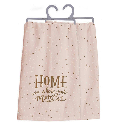 "A pink dishtowel with the words ""Home is Where Your Mom Is"" on a pink background with heart-shaped polka dots."