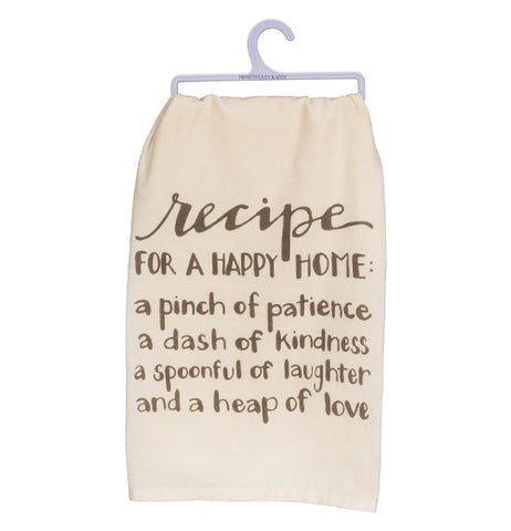 "A cream colored dish towel hanging from a white hanger with the words ""Recipe for a happy home. A pinch of patience, a dash of kindness, a spoonful of laughter, and a heap of love"" written in dark brown."