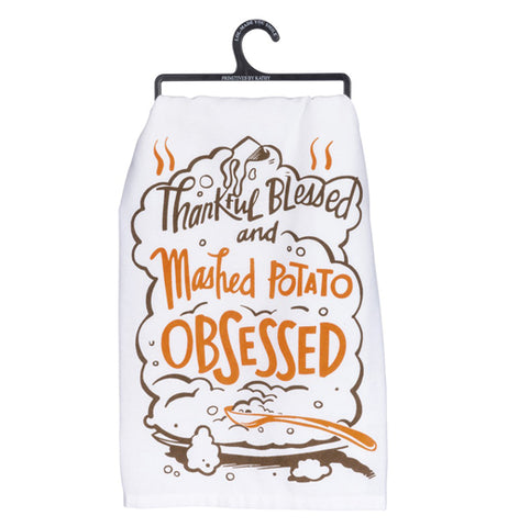 "White Mashed Potato dish towel with design of a platter of mashed potatoes with spoon and the words ""Thankful Blessed and Mashed Potato Obsessed"" in brown and orange above."
