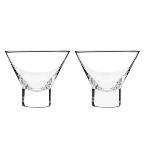 Two clear stemless martini glasses sitting next to each other on a white background.