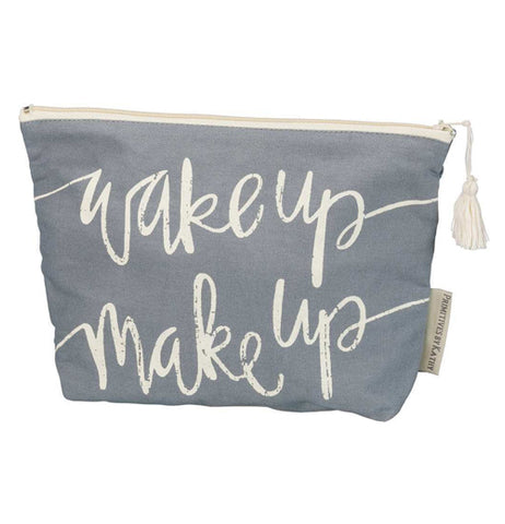 "This gray pouch with a white zipper on top has the words, ""Wake Up Make Up"" in white lettering."