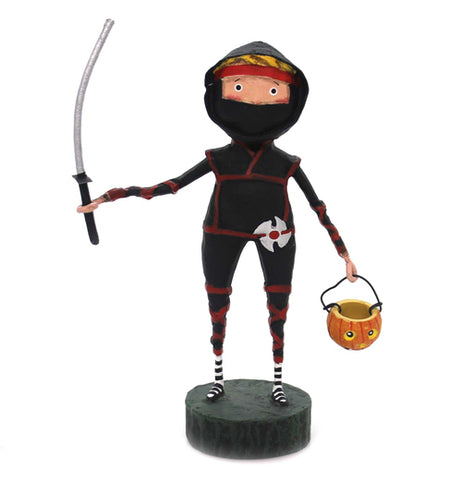 The figure of the Lil' Ninja warrior wears black and carries a sword in one hand and a Halloween basket on the other.