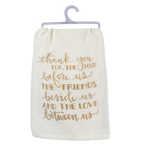 "The Dish Towel has gold metallic letters that say, ""Thank You For the Food Before Us, the Friends Besides Us, and the Love Between Us"" over a white background."