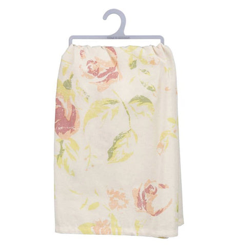 The back of the towel has a floral print of roses and leaves on a white background.