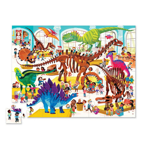 "The ""Dinosaur Day at the Museum"" puzzle features and illustration of children looking at assembled Dinosaur bones in the museum."