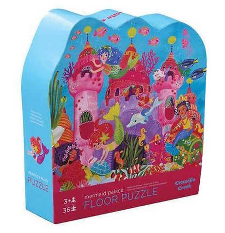 "The ""Mermaid Palace"" Puzzle with 36 pieces has a picture of a dark pink castle with sea animals and mermaids in blue box."