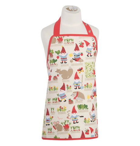 This white kitchen apron with a red outline features a design of gnomes in blue coats and red hats growing gardens with mice, hedgehogs, and foxes.