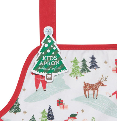 This close-up shot is of a corner of the Christmas apron with a green Christmas tree shaped tag attached to it.
