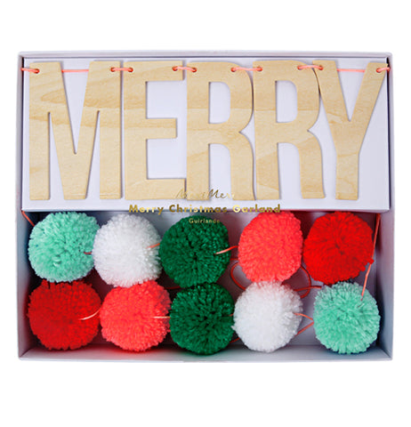 "The ""Merry Christmas"" banner is shown with its puffballs inside its packaging."