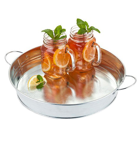 The galvanized metal serving tray is shown with two jars full of lemons and ice tea. Two leaves stick out of both drinks.