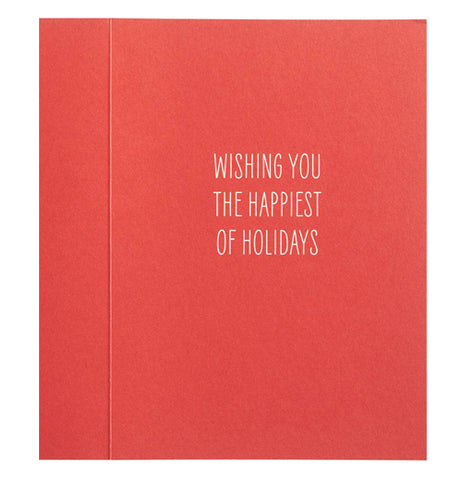 "The interior of the card is red with the white-lettered words, ""Wishing You The Happiest of Holidays""."
