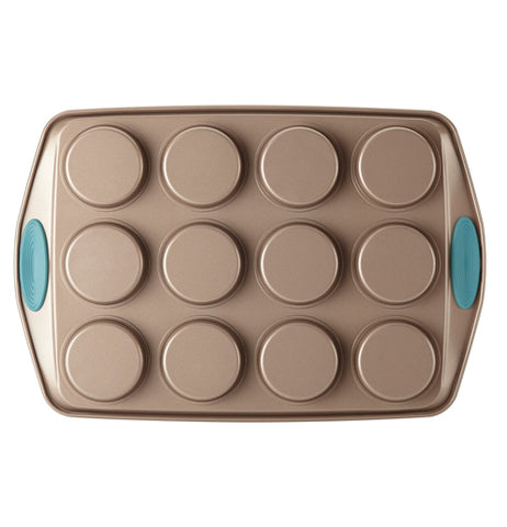 "The ""Blue"" 12 Cup Muffin Pan is shown from the bottom that showed the deepness of the cup holes with the blue handles."