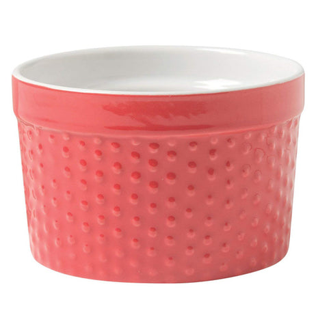 A red ceramic Ramekin cups made for desserts and dips.